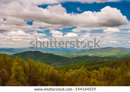 Early spring yellows and greens in Shenandoah National Park, seen from an overlook on Skyline Drive. - stock photo