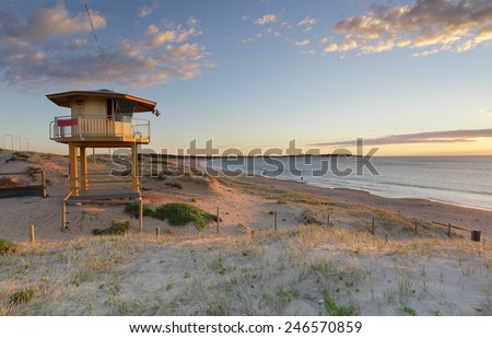 Early summer morning  at Wanda beach with golden sunlight falling on the Wanda  surf lifeguard tower - stock photo