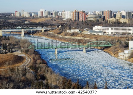 Early winter view of the s shape north saskatchewan river valley and downtown highrise apartment and office buildings, edmonton, alberta, canada - stock photo