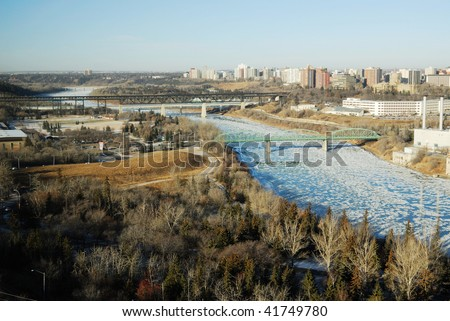 Early winter view of the s shape north saskatchewan river valley, downtown highrise apartment and office buildings, edmonton, alberta, canada - stock photo
