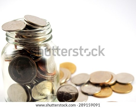 Earn and save money, economy, collected coins, Thai baht, in glassware, isolated on white background - stock photo
