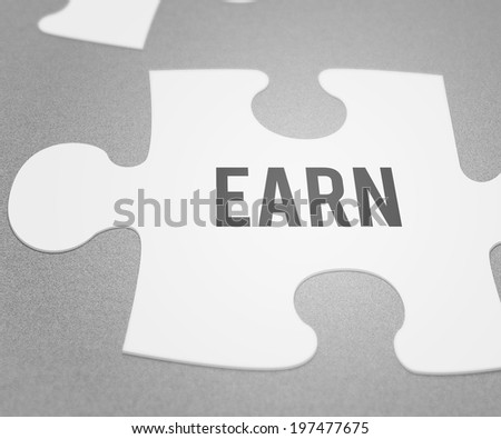 Earn Puzzle - stock photo
