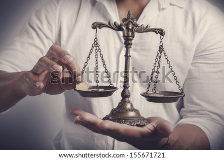 Earning balance concept with businessman with money - stock photo