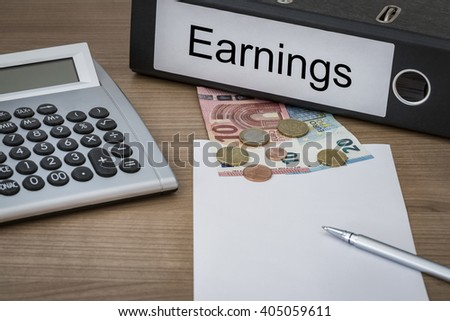 Earnings written on a binder on a desk with euro money calculator blank sheet and pen - stock photo