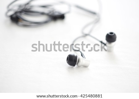 Earphones close-up. Concept of Music. - stock photo