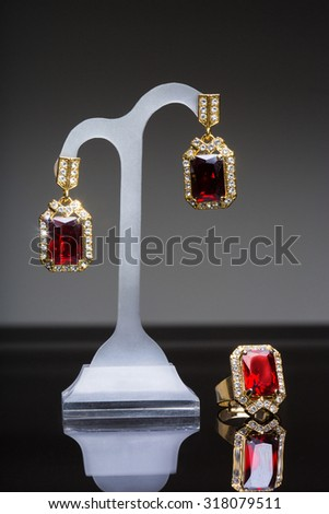 earring and ring with colorful red gems