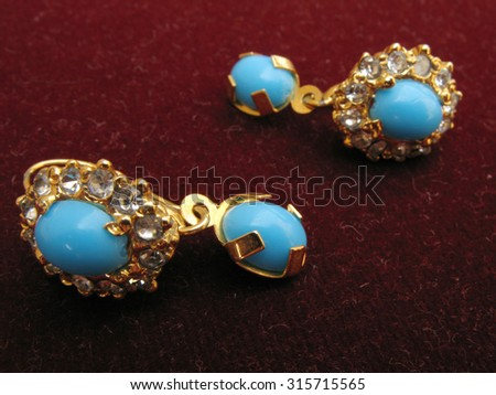 Earring with precious blue stone - stock photo