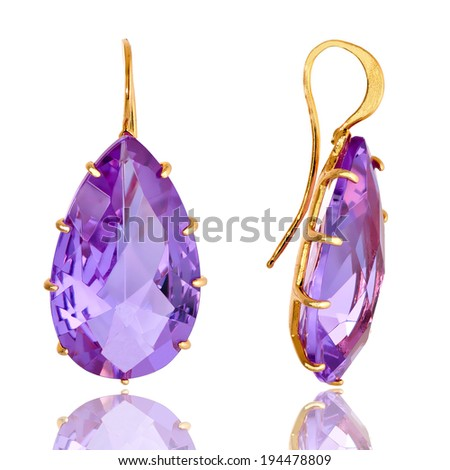Earrings glass. Transparent color is purple. Isolated on white background  - stock photo