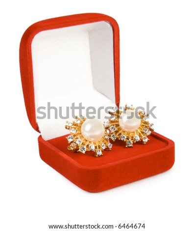 Earrings in red box. Isolate on white. - stock photo
