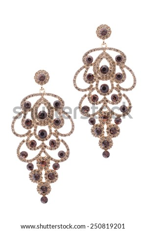 earrings inlaid with precious stones on a white background - stock photo