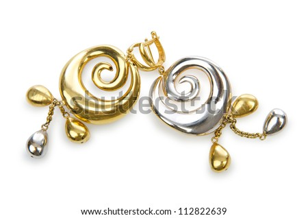 Earrings isolated on the white - stock photo