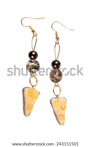 Earrings made of plastic in the form of the cake with lemon Isolated on white background. - stock photo