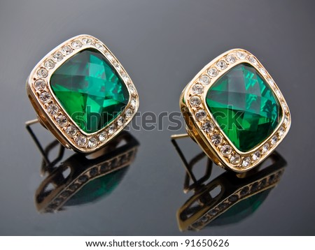 Earrings with green jewelry stone - stock photo