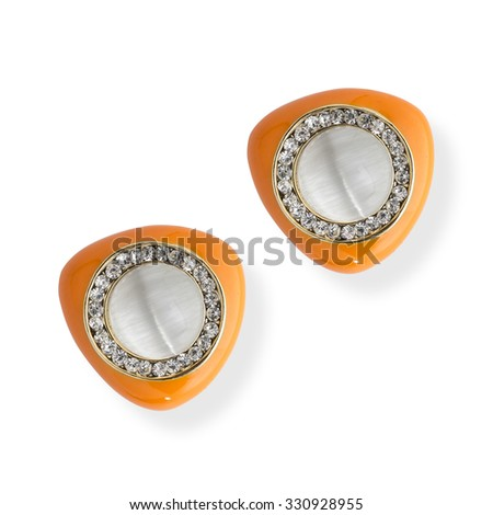 Earrings with pearls isolated on white - stock photo