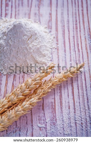 ears of wheat and flour on vintage wooden board food and drink concept  - stock photo