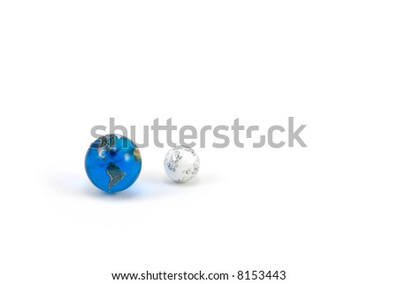 Earth and Moon Marbles isolated on White Background - stock photo