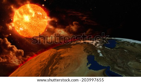 Earth and Sun global warming concept - stock photo