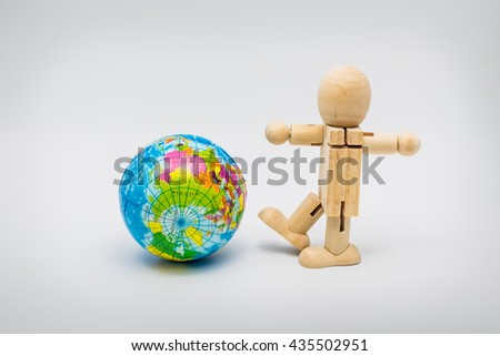 Earth and wooden dummy - stock photo