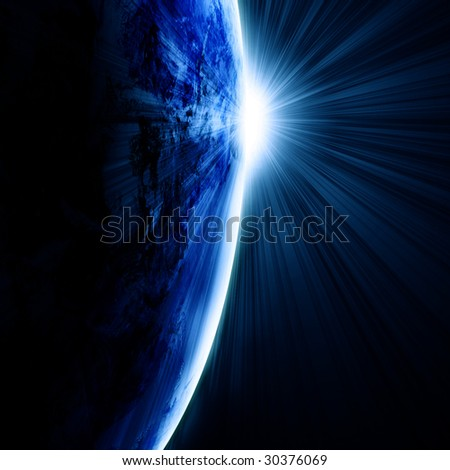 Earth as seen from space with sunrise - stock photo