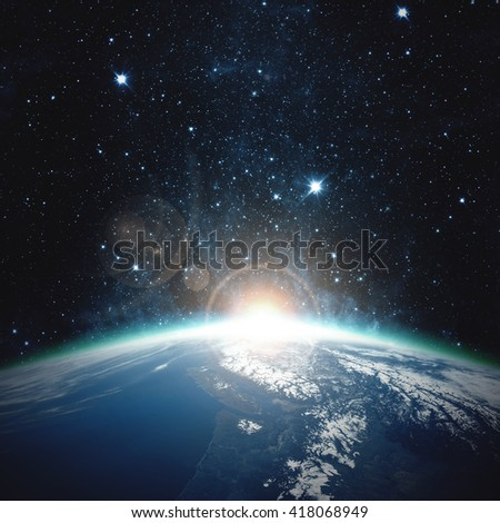 earth blue shining - Elements of this image furnished by NASA - stock photo