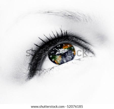 earth clock in eye - stock photo