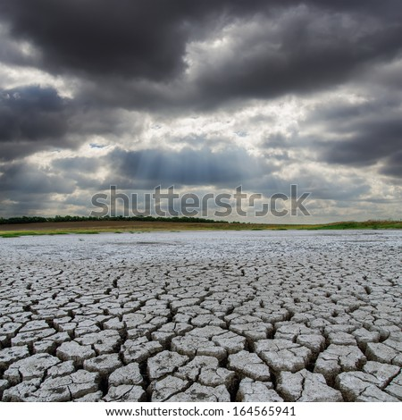 earth desert and low clouds over it - stock photo