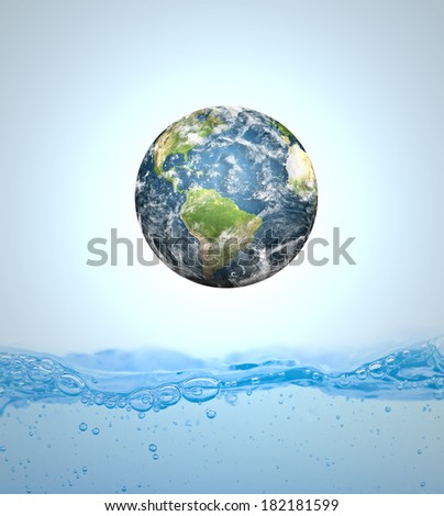 Earth falling into water (Elements of this image furnished by NASA) - stock photo