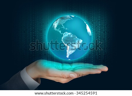 Earth floats on the human hand over digital background - stock photo