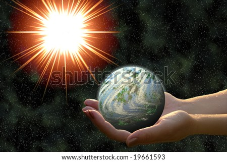 earth-formed planet in woman hands in open space - stock photo