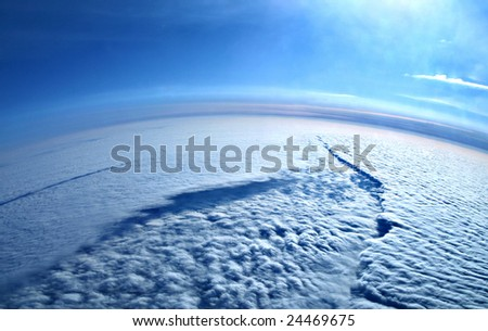 Earth from above  the clouds - river-like cloud formation - stock photo