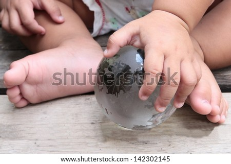 Earth glass globe in hand