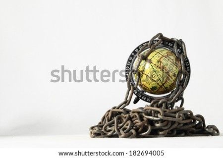 Earth globe close in chain and padlock - stock photo