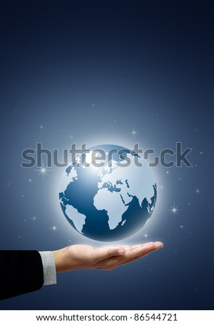 Earth globe in businessman hand on star and blue background - stock photo