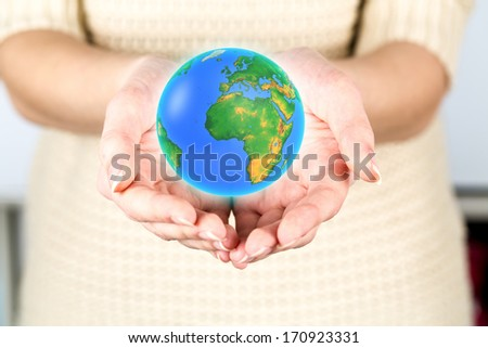 earth globe in female hands, Elements of this image furnished by NASA
