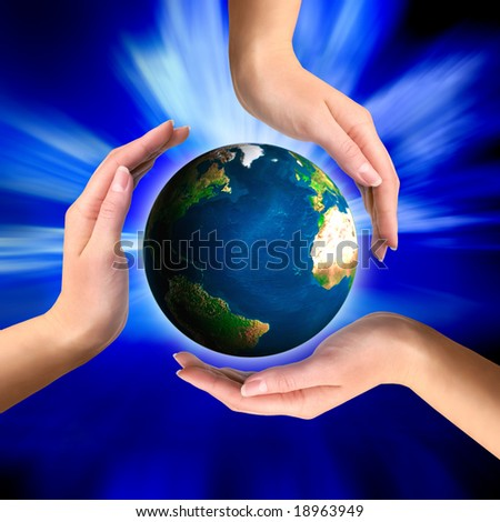 Earth globe in hands Conceptual recycling symbol - stock photo