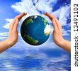 Earth globe in hands Environment and ecology concept - stock photo