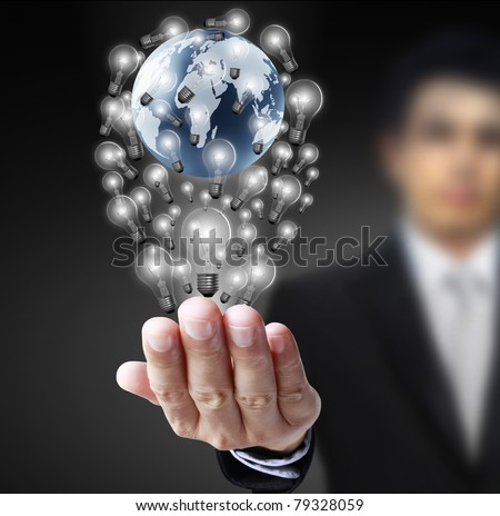 earth globe in his hands - stock photo