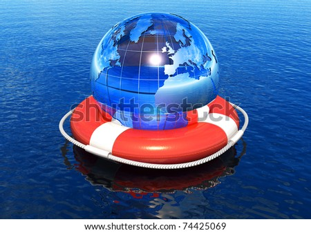 Earth globe in lifebuoy floating in water - stock photo