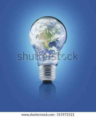 Earth globe in light bulb on blue background, Energy conservation and environmental concept, Elements of this image furnished by NASA - stock photo