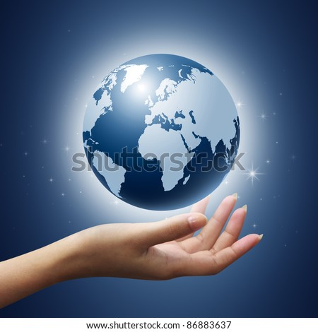 earth globe in woman hands on blue background - stock photo