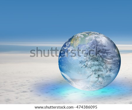 "Earth globe over clouds and snowy pine tree ""Elements of this image furnished by NASA"""