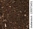 Earth ground covered with compost mulch fragment as a texture background - stock photo