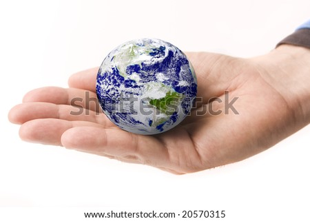 Earth in a male hand isolated on white