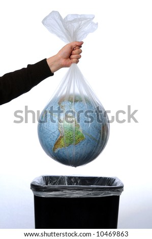 Earth in a trash bag being thrown away - stock photo