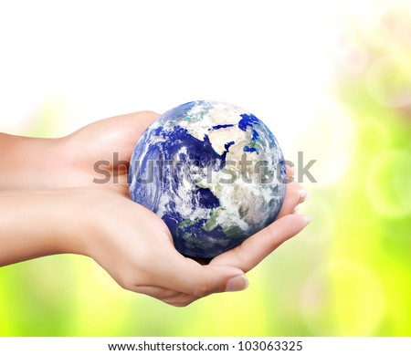 earth in hand (Elements of this image furnished by NASA) - stock photo
