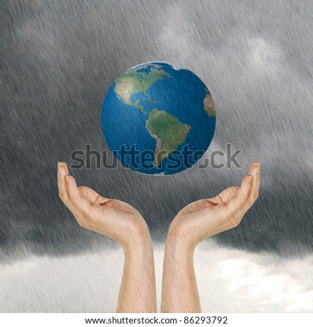 earth in hands and raining, photo of Earth from NASA