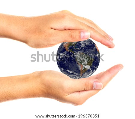 Earth in hands. Elements of this image are furnished by NASA - stock photo