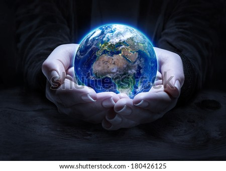 earth in hands - environment concept  - Europe, elements of this image furnished by NASA   - stock photo
