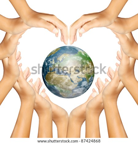 earth in hands making a heart - stock photo