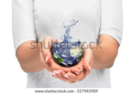Earth in human hand - stock photo